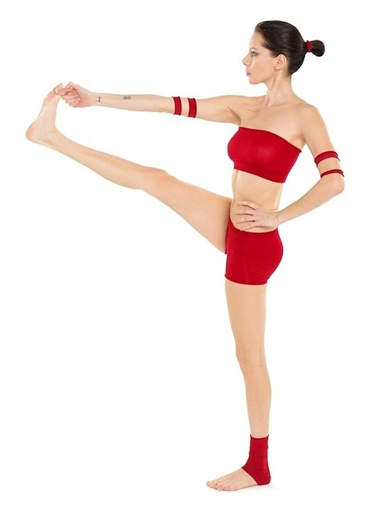 The Padangusthasana Variation - woman doing yoga